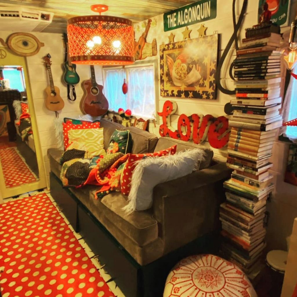 Grey sofa in tiny room living space with large love sign