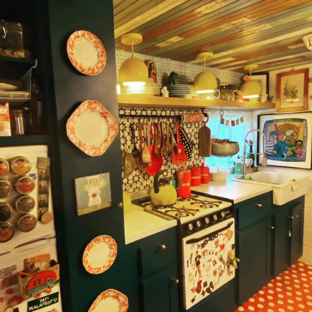 Tiny house kitchen with black cabinetry