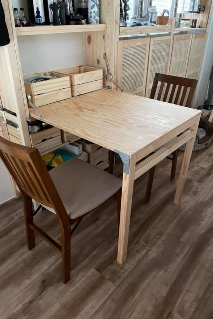 Fold down table in tiny house kitchen