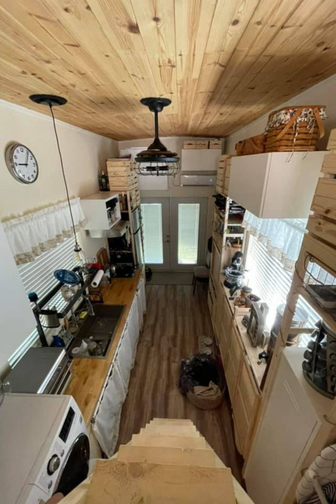 View from loft into tiny house kitchen