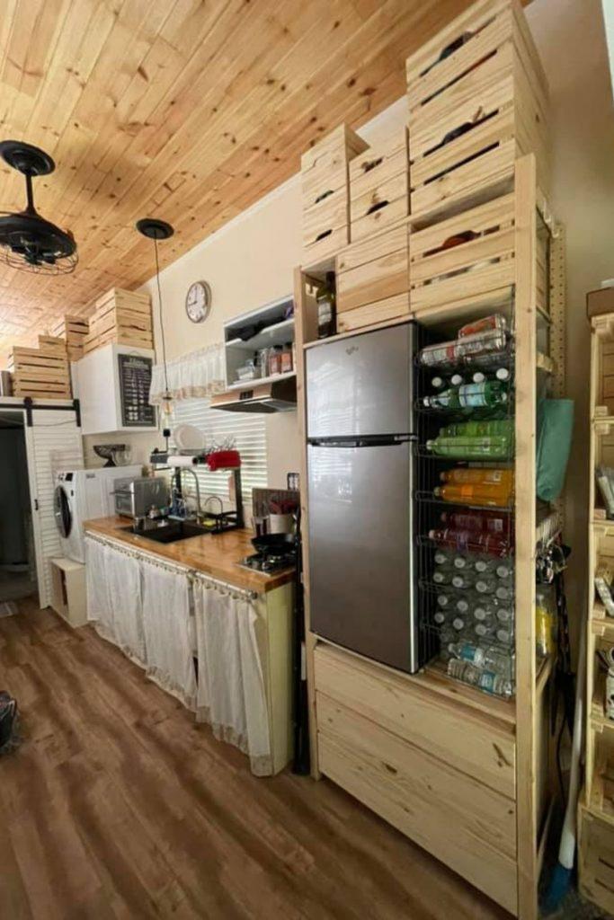 Refrigerator and beverage case in kitchen