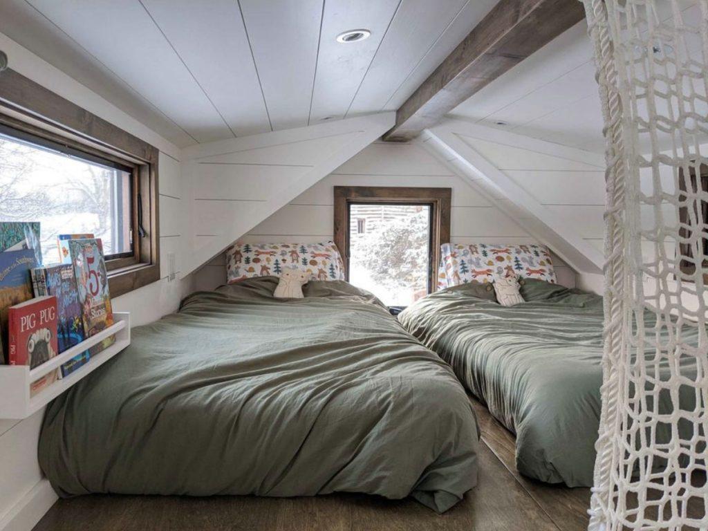 Two twin beds in loft by window