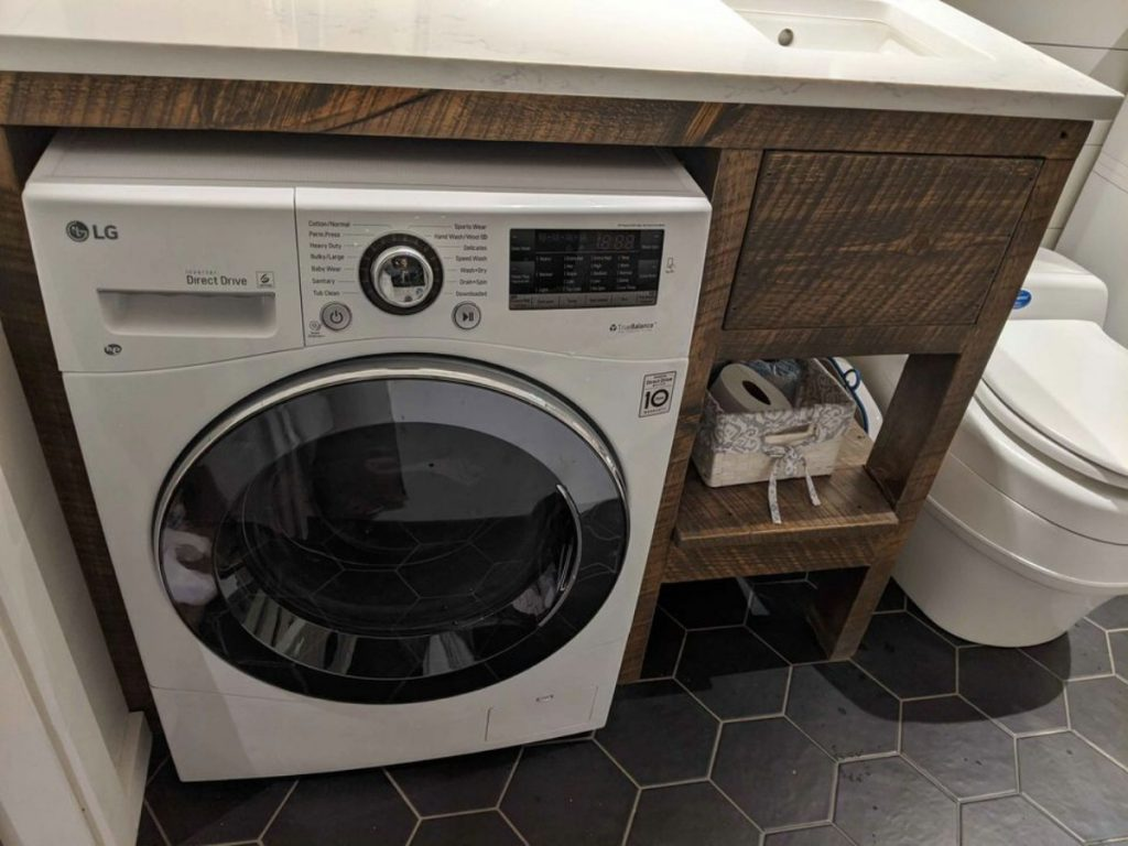 Washer and dryer combination unit under bathroom counter
