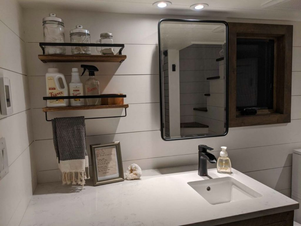 Bathroom counter with floating shelves above