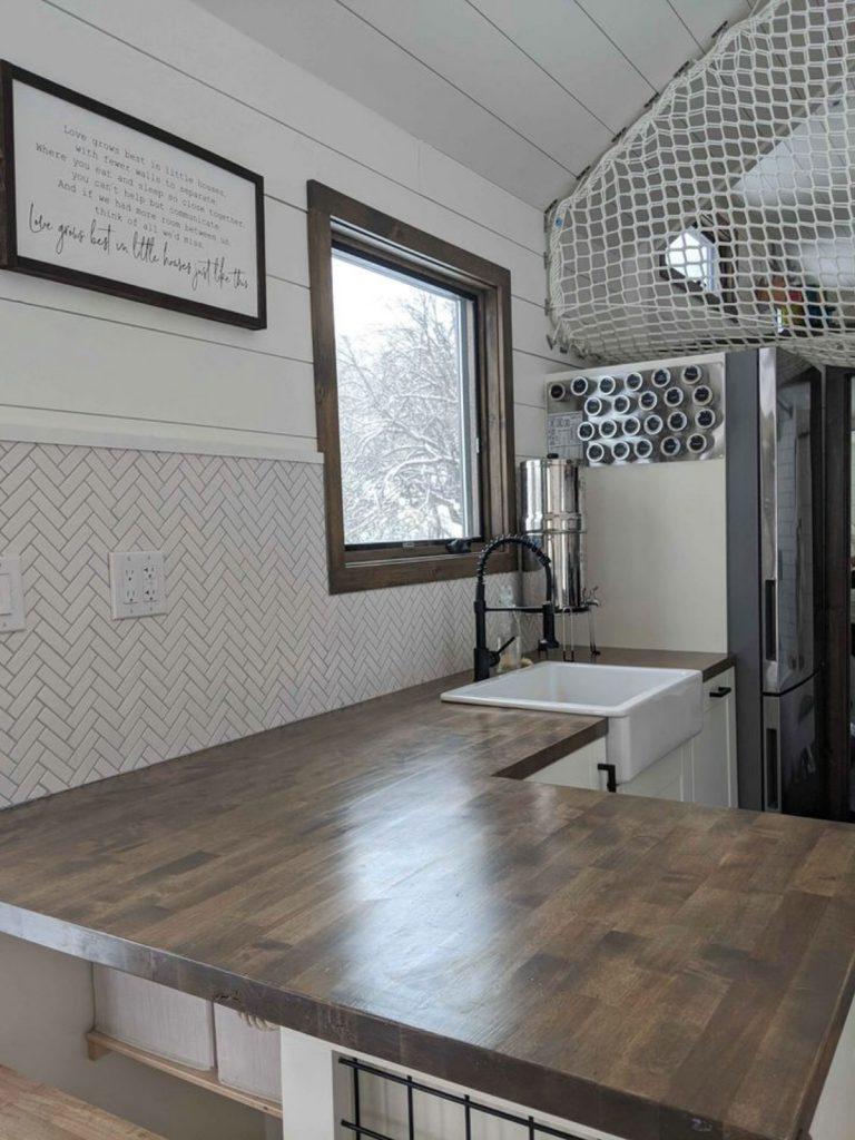 Dark butcher block countertop in tiny home