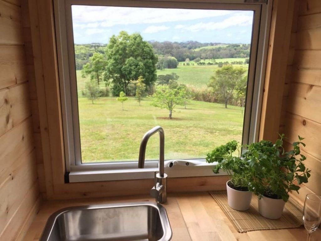 Kitchen sink by large window