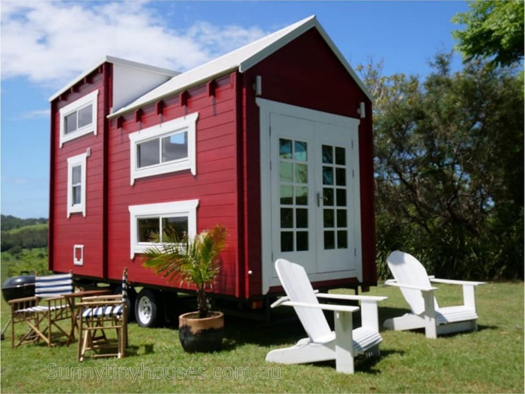 Red tiny house on wheels