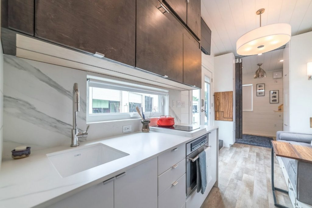 White kitchen counter and farmhouse sink with stove