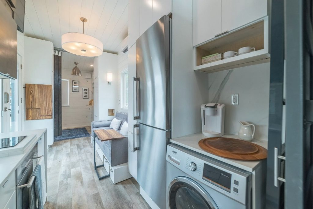 Stainless steel refrigerator and laundry unit in tiny house