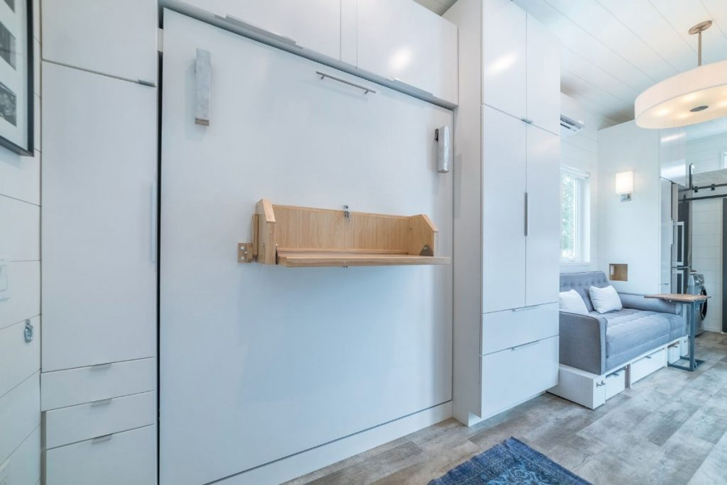 Wooden rack against murphy bed unit