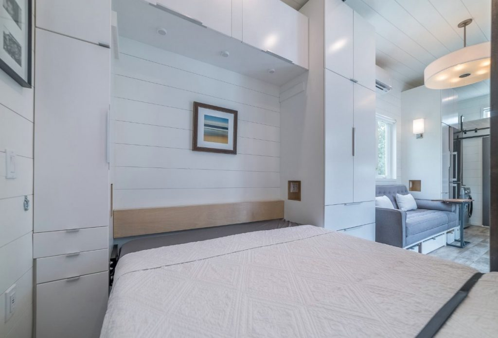 Murphy bed headboard with picture on wall