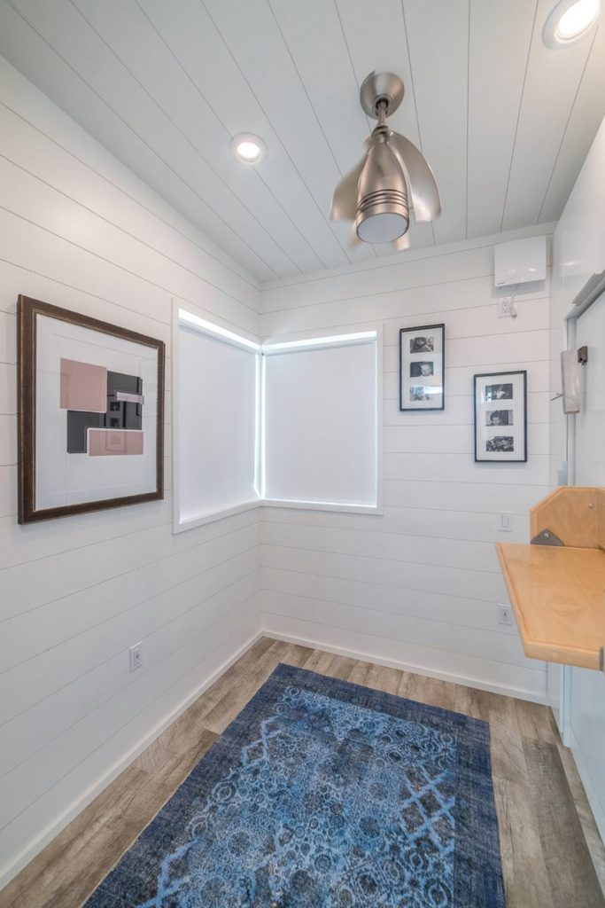 Tiny house bedroom with blue rug