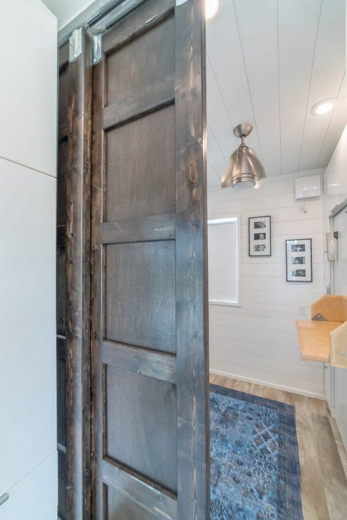 Barn door to bedroom partially open