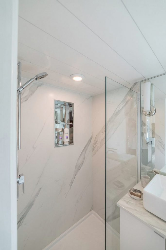 Glass lined shower in tiny home bathroom