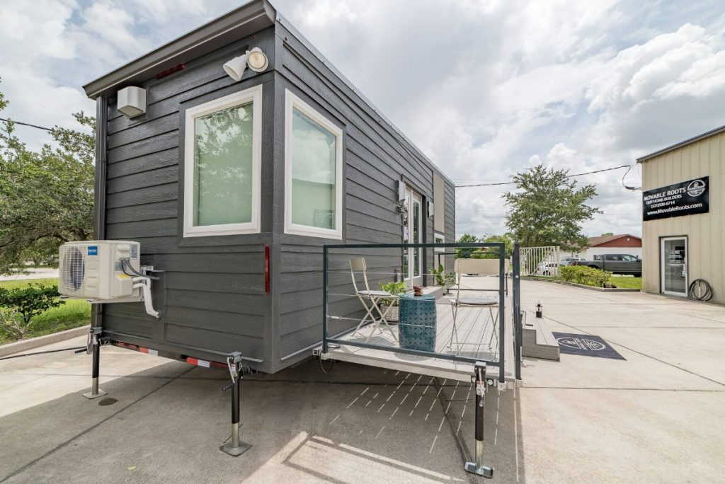 End of tiny house with windows and porch