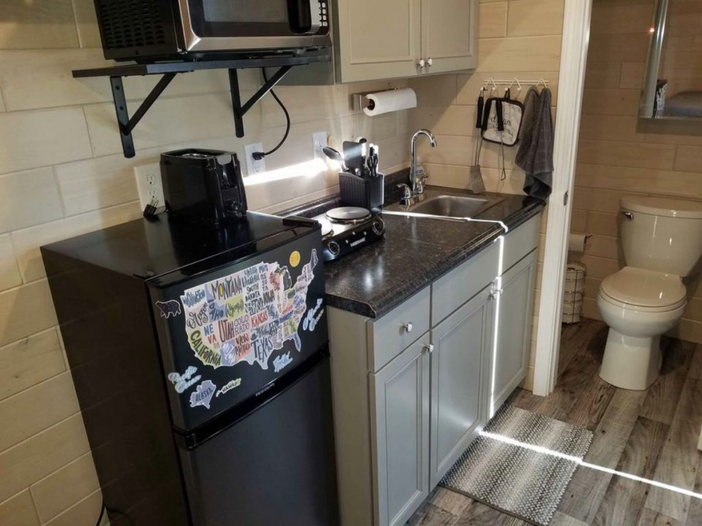 Kitchenette space with black mini refrigerator