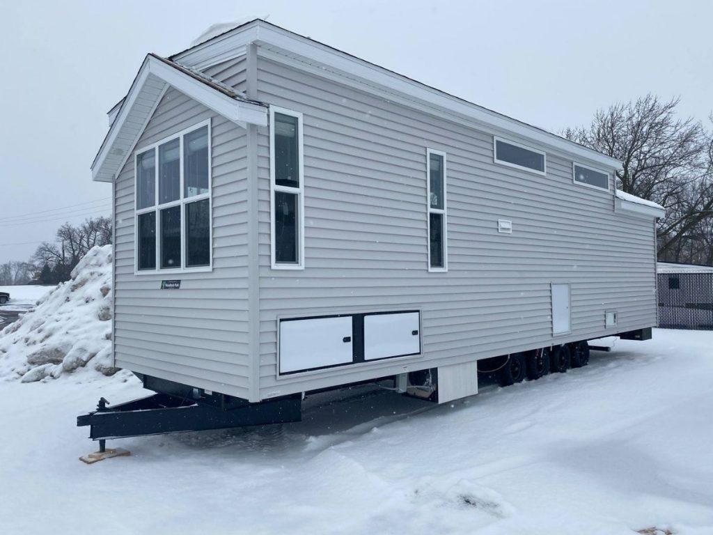 Grey park model in snow