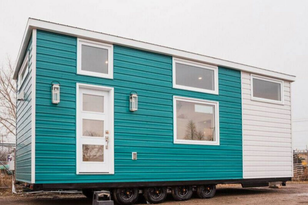 Teal tiny house with white accents