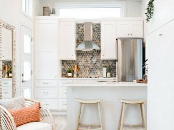 White kitchen with island and bar stools