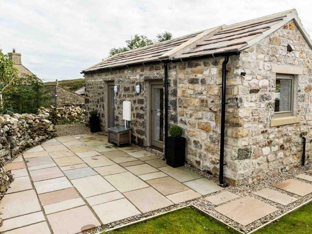 Stone cottage on knoll
