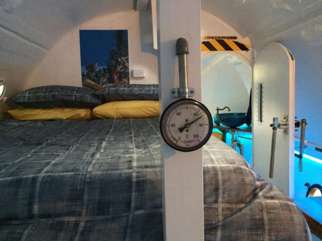 Bunk with thermometer on beam in submarine