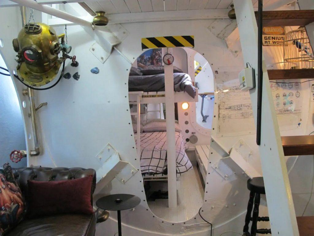 Oval door in tiny submarine house