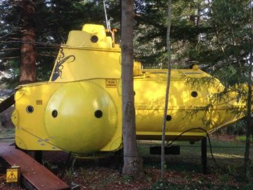 Side of tiny yellow submarine house