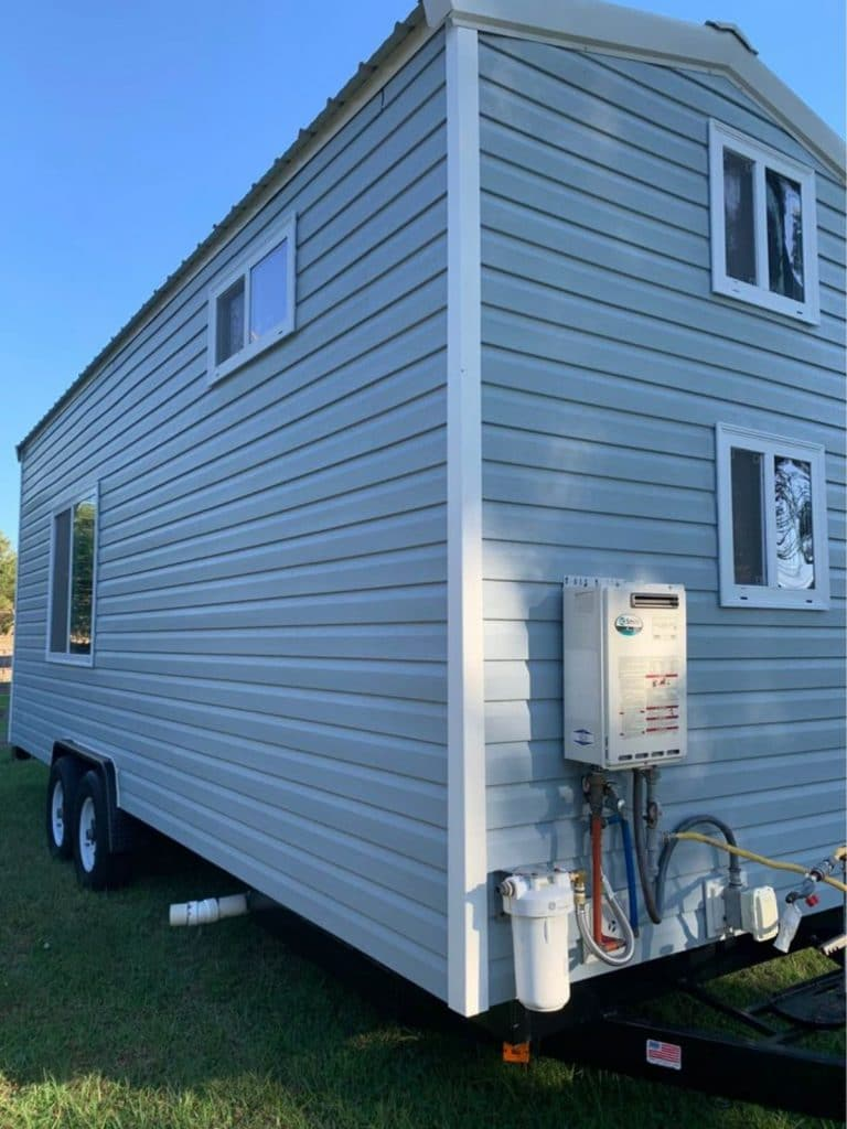 Back of tiny house showing electrical