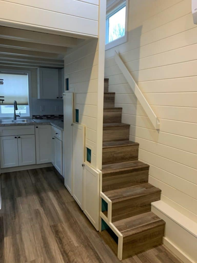 STairs leading to tiny loft with partial wall
