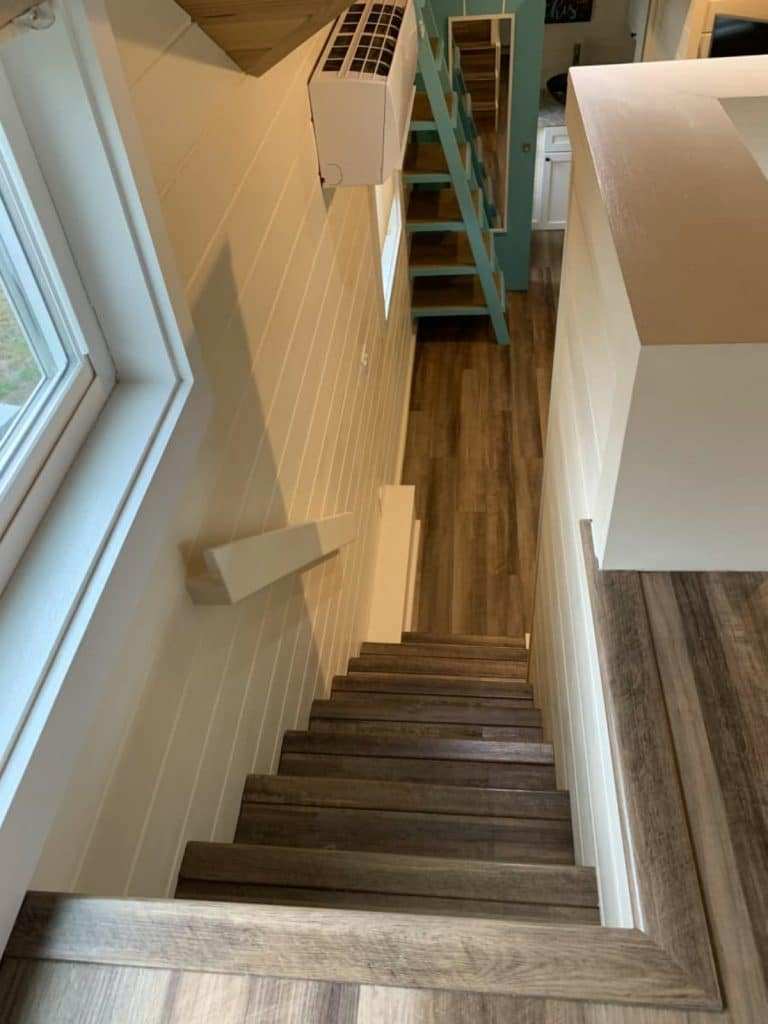 View down tiny house stairs into main floor