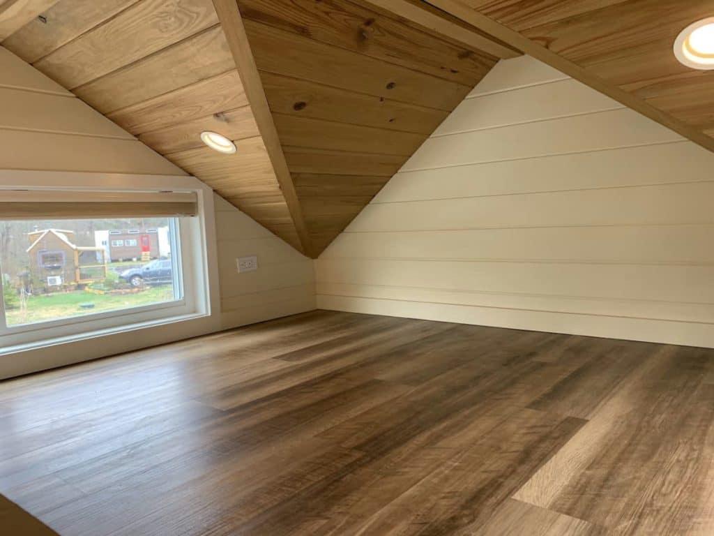 Hardwood floor in tiny house loft