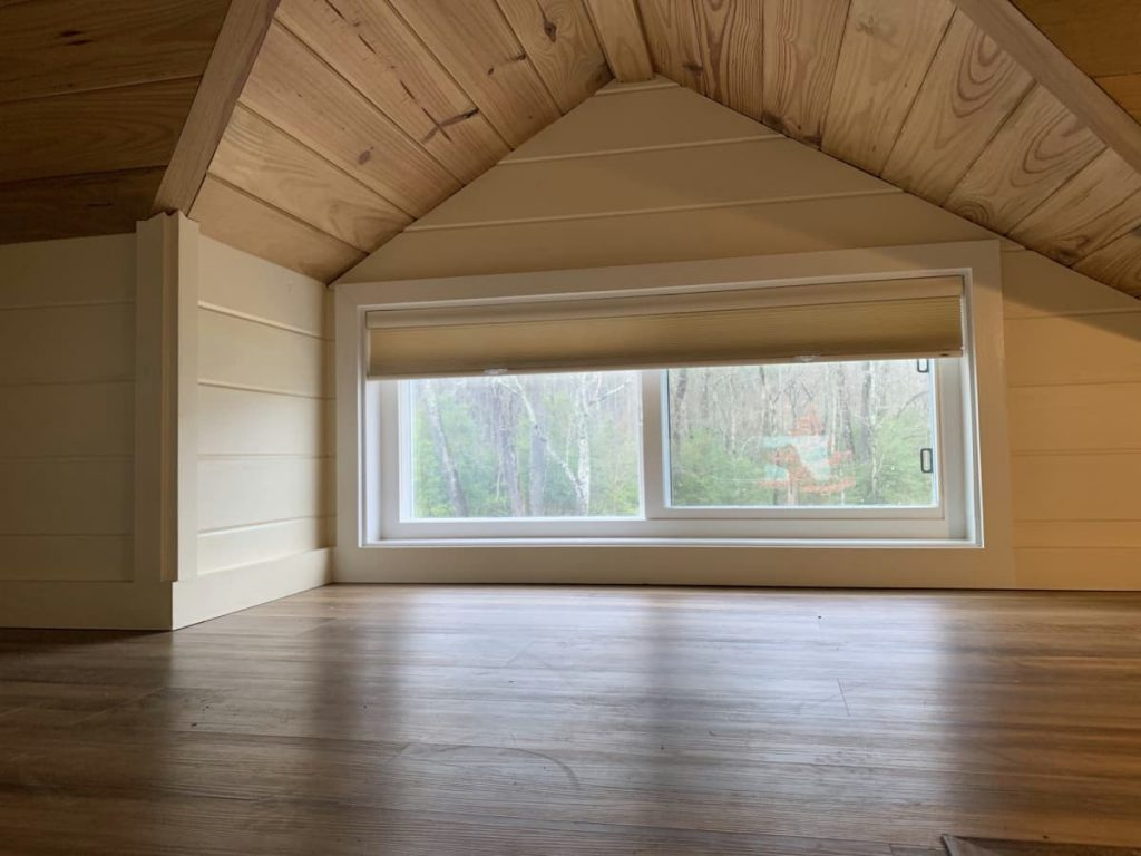 Windows in loft under eave of house