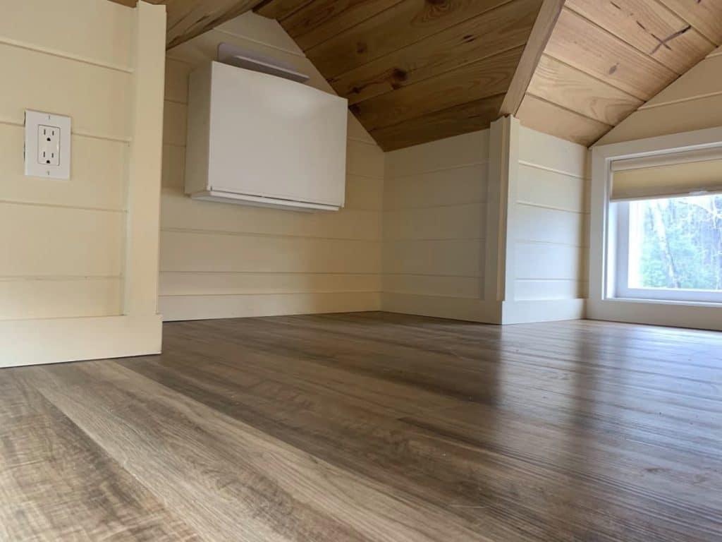 Loft with window unit under eave