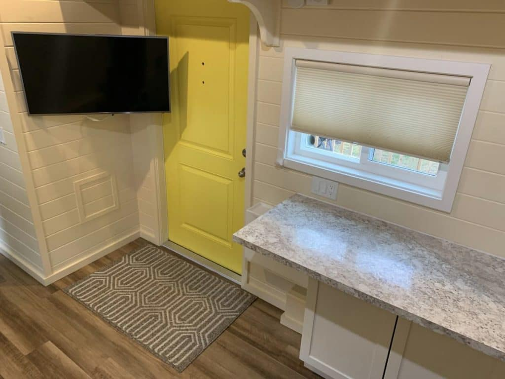 View down into tiny living space with yellow door