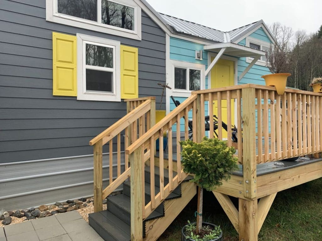 Close up front porch of tiny house with stairs