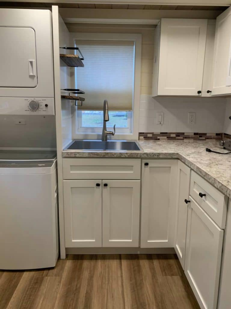 White kitchen with cabinets sink and laundry