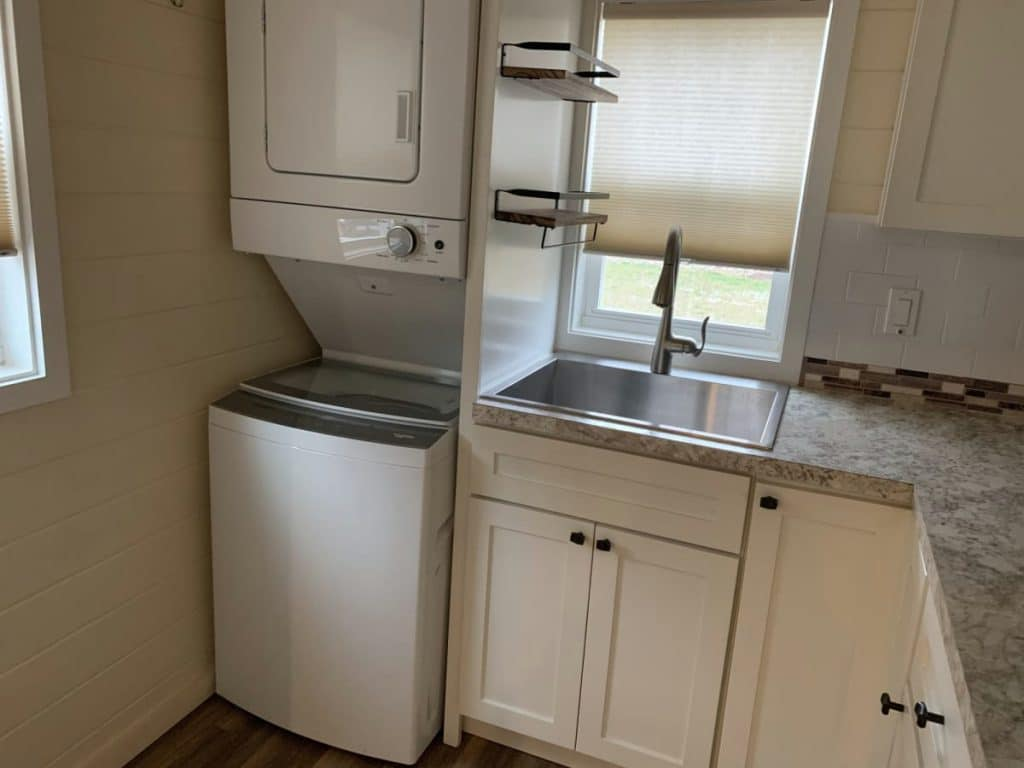 Stacking laundry unit in corner of kitchen