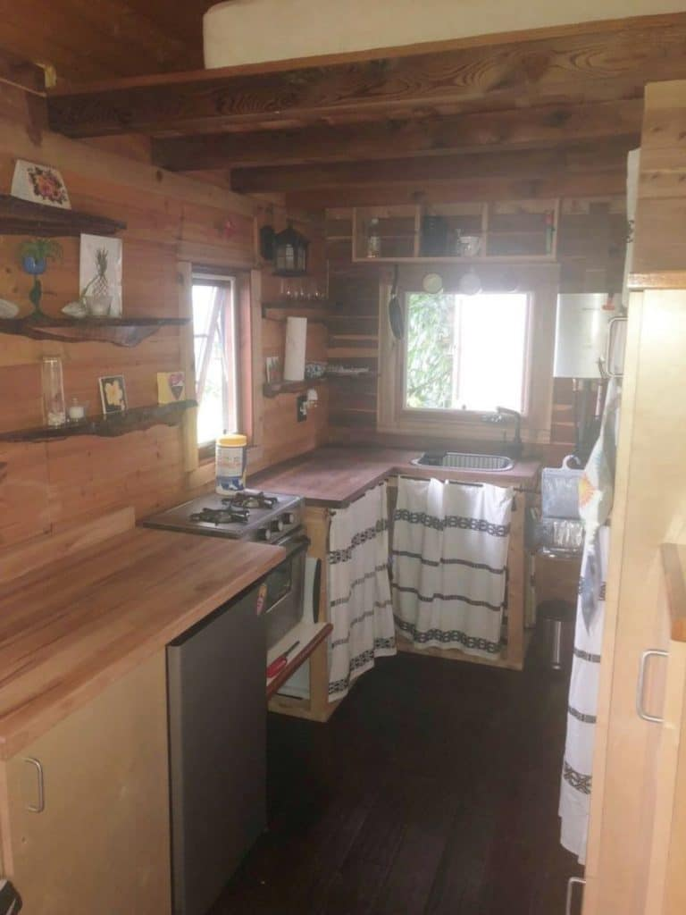 Butcher block counters in tiny cabin kitchen