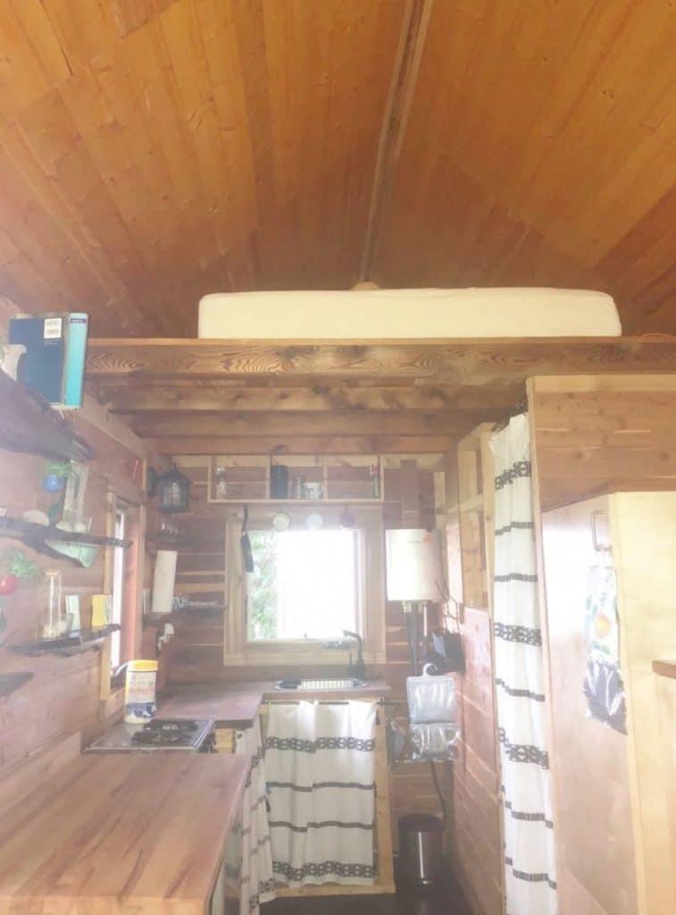 Loft in cedar tiny cabin above kitchen