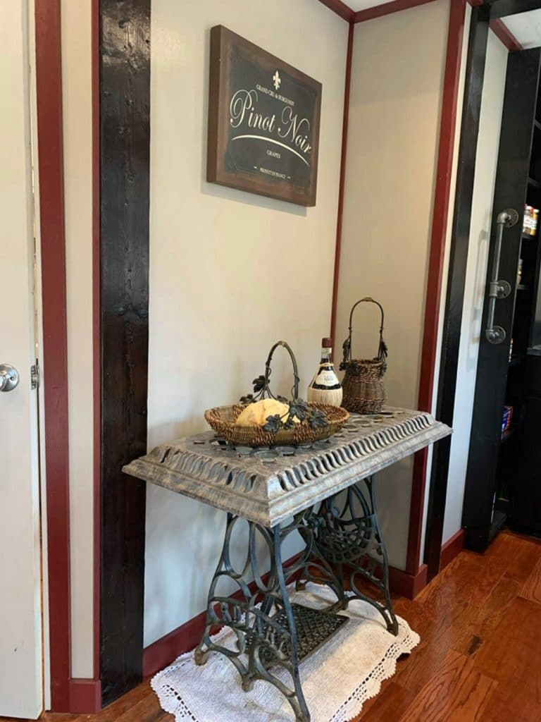 Small side table against wall with decor items