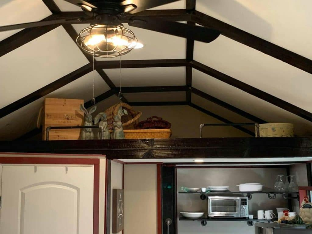 Loft above kitchen with old luggage