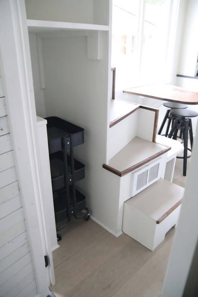 Storage nook behind stairs to loft