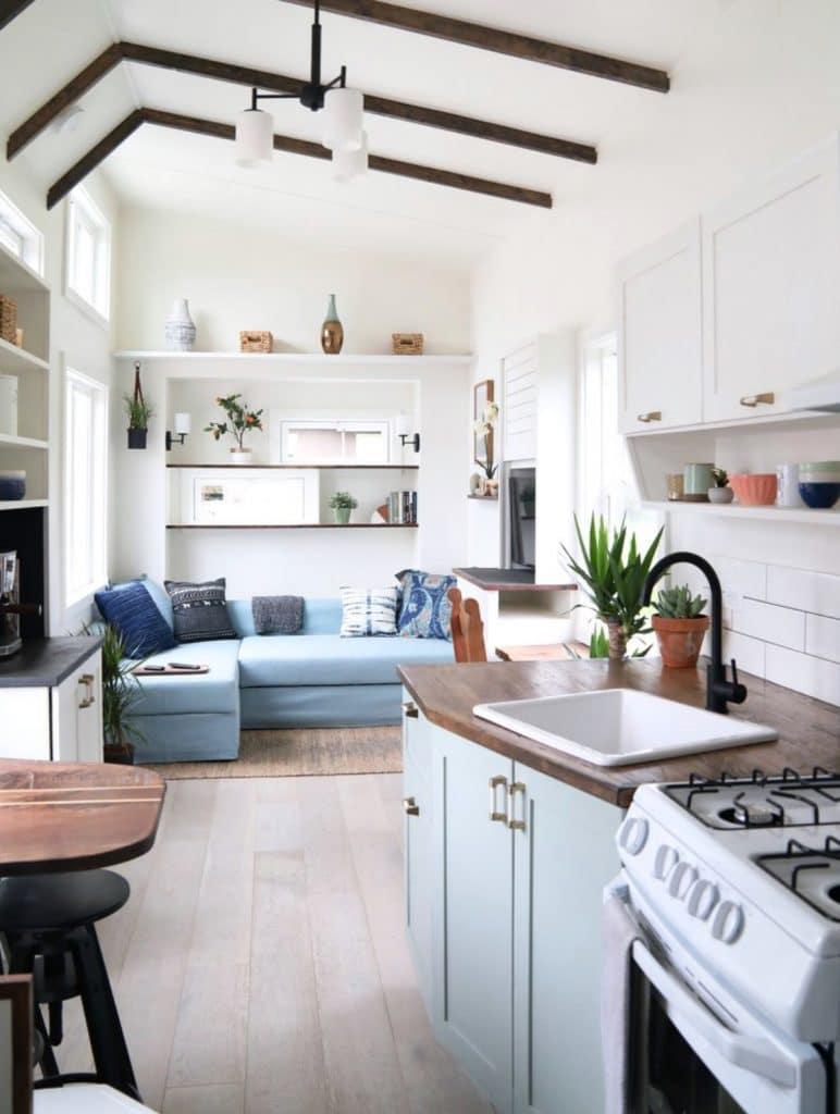 White gas stove next to kitchen sink