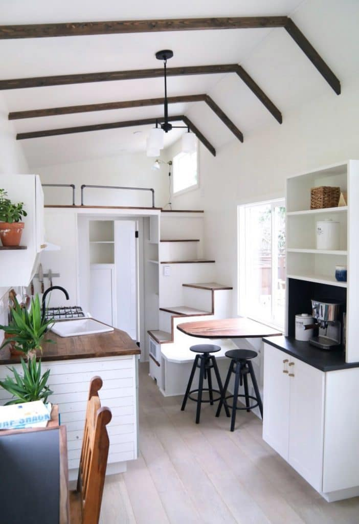 Dining table by stairs to loft