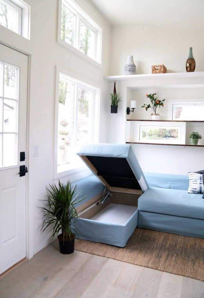 Blue sofa with end lounge open for storage