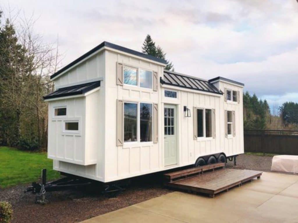 White tin house on concrete pad
