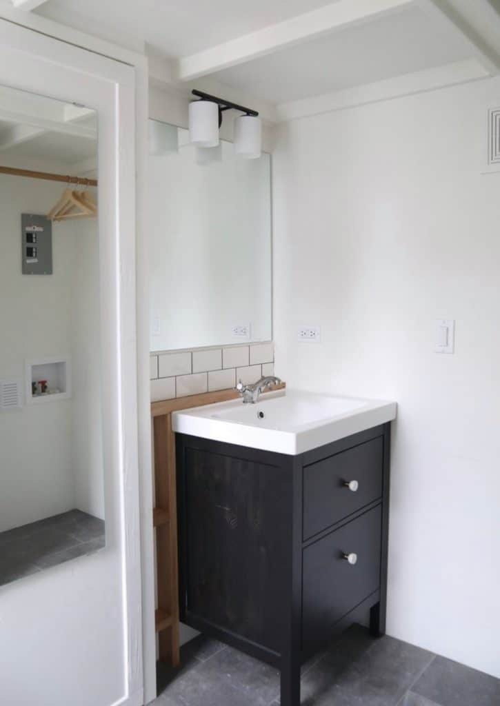 Navy vanity in tiny bathroom