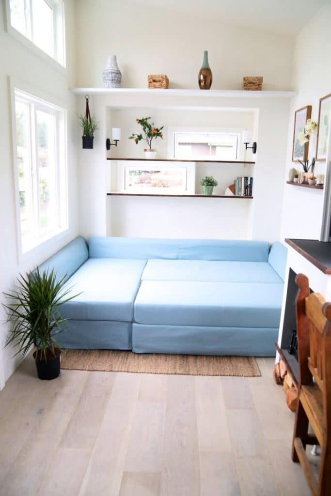 Blue sectional sofa folded down to create bed