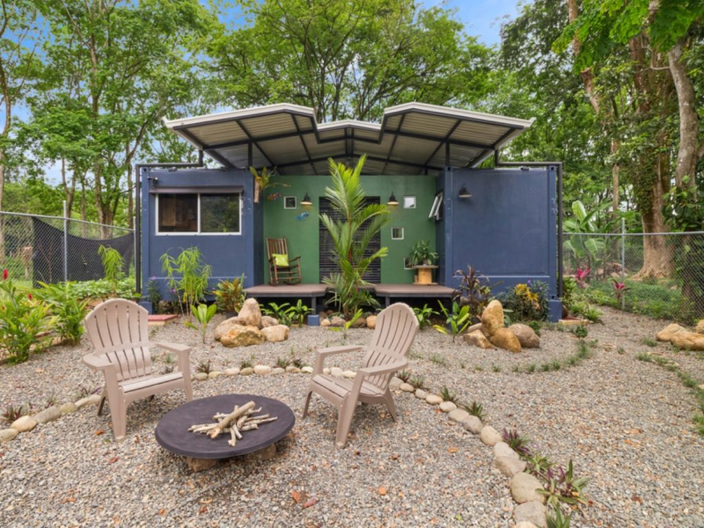 Front of blue and green container home