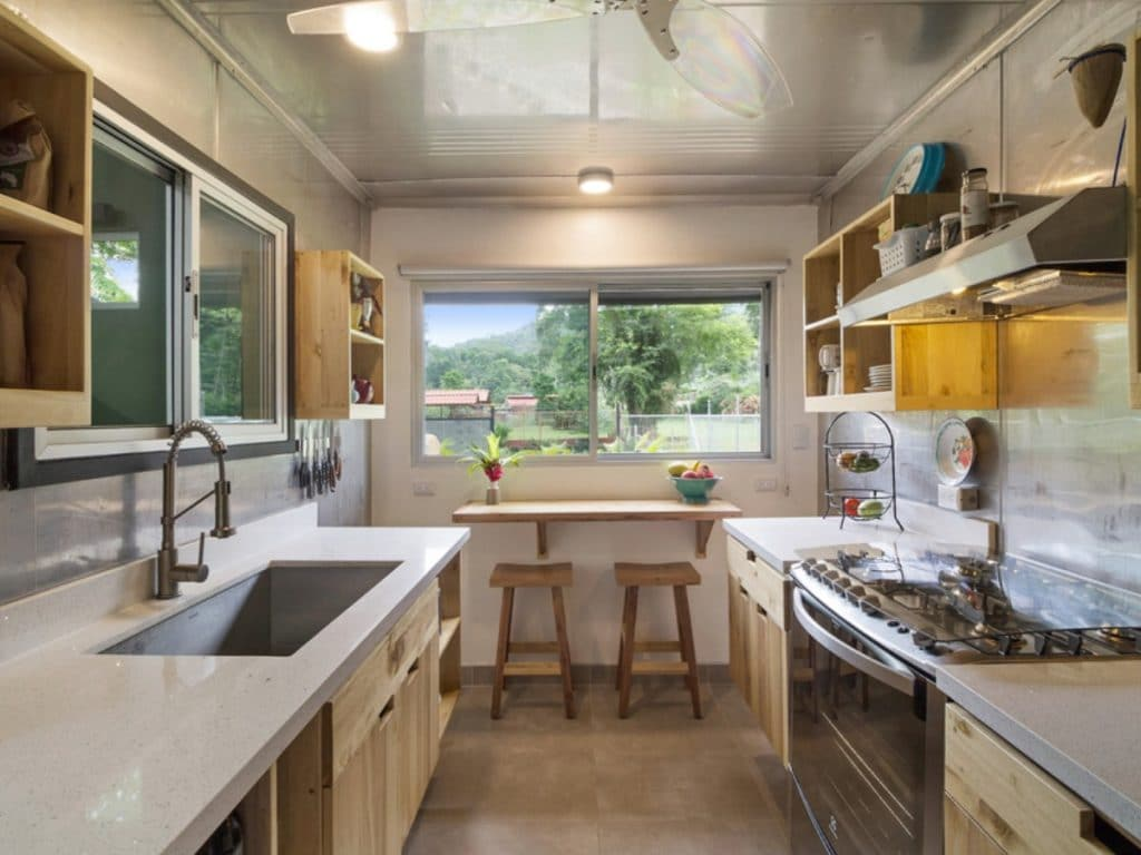 Galley kitchen with sink on left and stove on right
